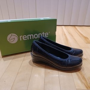 Remote black patent leather shoes